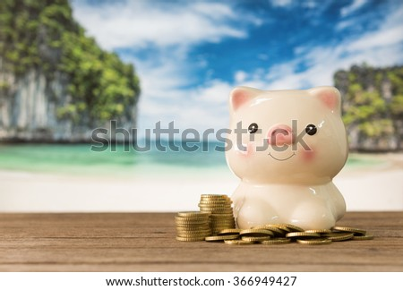 summer piggy bank with golden coins on the beach. concept of holiday,