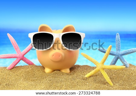 Summer piggy bank with sunglasses and starfishes on beach - stock photo