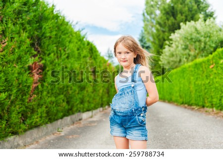 Summer portrait of a cute little girl of seven years old - stock photo