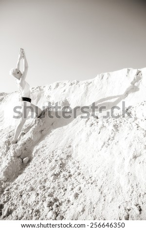 summer portrait of attractive woman in sand - stock photo