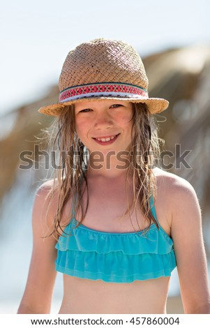 summer portrait of beautiful little girl on the beach