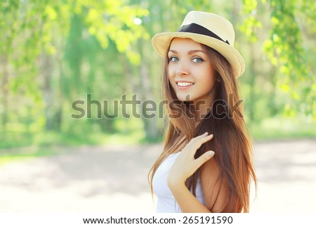 Summer portrait of beautiful young girl in hat on nature - stock photo