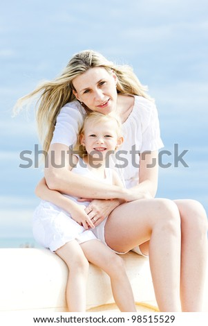 summer portrait of mother with her daughter