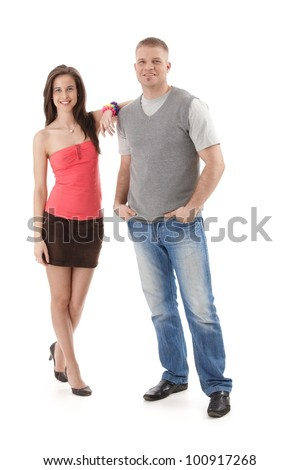 Summer portrait of trendy couple smiling, girl in mini skirt and high heels, isolated on white, full length.