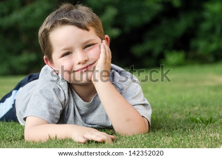 Summer portrait of young child outdoors - stock photo