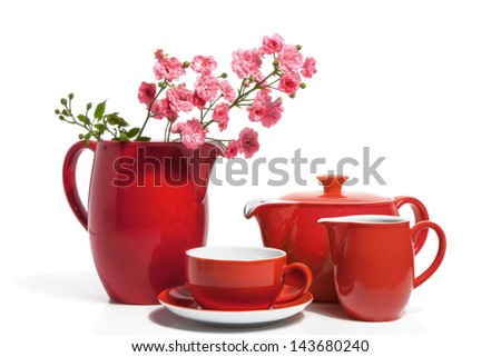 Summer Red Dishware with Pink Roses, isolated on white - stock photo