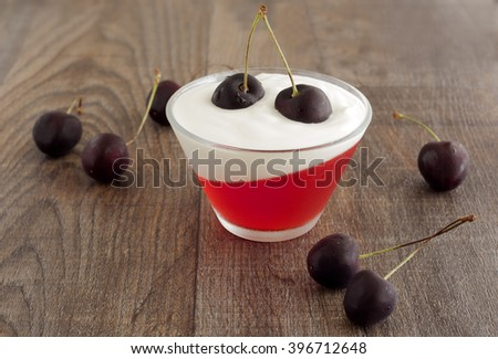 Summer refreshing dessert with black cherries, yogurt and red jelly.