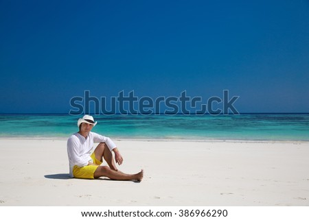 Summer. Relax. successful man resting on exotic beach. Vacation Travel. Bliss freedom seashore concept.  - stock photo