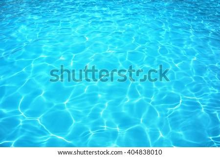 Summer resort water reflection, water ripple under bright sunny sky.  - stock photo