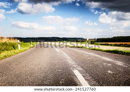 Summer road with cloudy sky. Travel concept  - stock photo