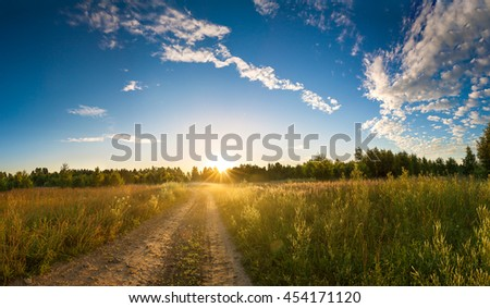 summer rural landscape with  blue sky, fog and the road.  sunrise panorama - stock photo