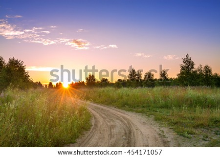 summer rural landscape with  blue sky, the road.  sunrise
