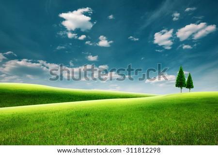 Summer rural landscape with green hills under blue skies - stock photo