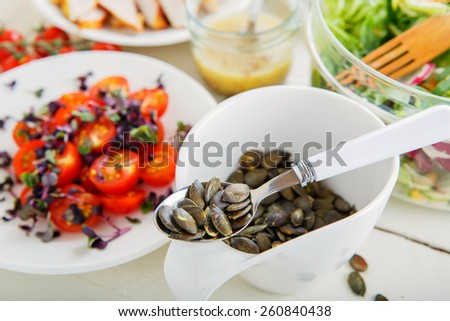 Summer salad with grilled meat, smoked fish and different vegetables - stock photo