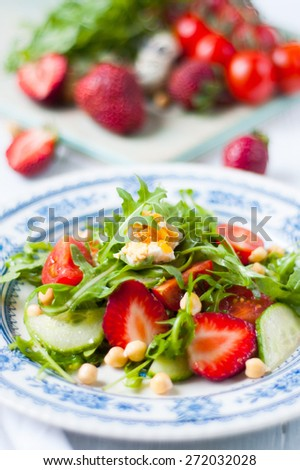 summer salad with strawberries and tomatoes