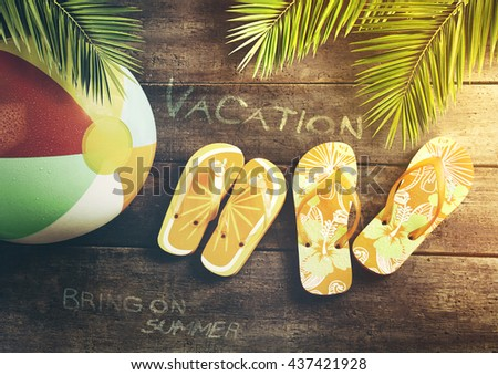 Summer sandals with beach ball on wood background - stock photo