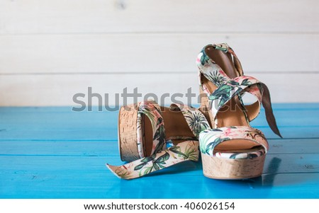Summer sandals with tropical print. - stock photo