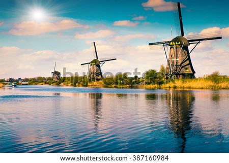 Summer scene in the famous Kinderdijk canal with windmills. Old Dutch village Kinderdijk, UNESCO world heritage site. Netherlands, Europe. - stock photo