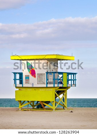 Summer scene with a typical colorful lifeguard house in Miami Beach, Florida at sunset  blue sky and ocean in the background, - stock photo