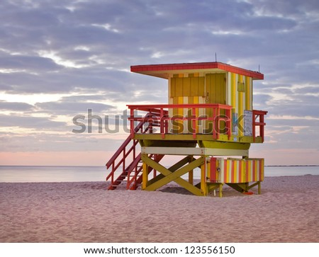 Summer scene with typical colorful lifeguard tower in Miami Beach Florida, light painting and long exposure before sunrise. World famous travel location.