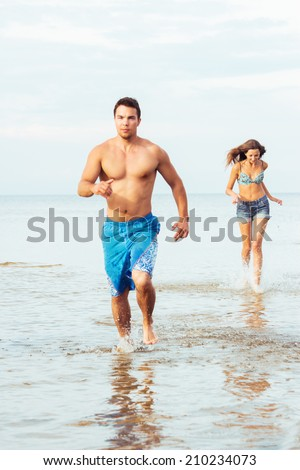 Summer, sea. Attractive couple on the beach