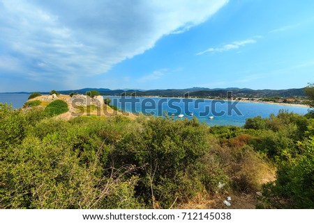 Summer sea coast landscape with old ruins of Ancient City Toroni fort (Halkidiki, Sithonia, Greece).