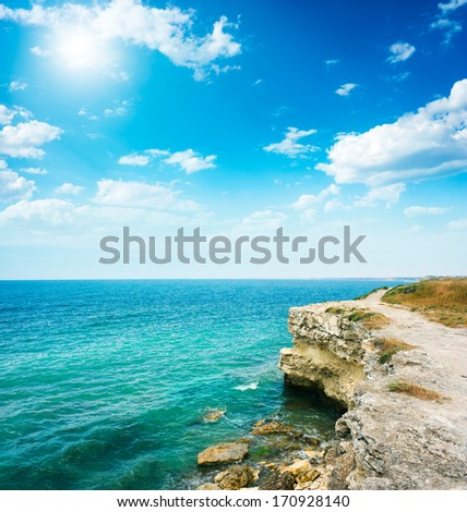Summer Sea Landscape with Rocky Shore and Beautiful Blue Sea. Copy Space. - stock photo