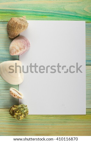 Summer sea vacation background. Notebook blank page with Travel items on blue green wooden table. Sea shells, pebbles, top view mock up - stock photo