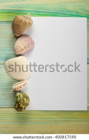 Summer sea vacation mockup background. Notebook blank page with Travel items on blue green wooden table. Sea shells, pebbles, top view. - stock photo