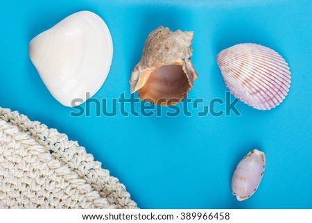 Summer sea vacation mockup background. Notebook blank page with Travel items on blue table. Sea shells, pebbles, top view.