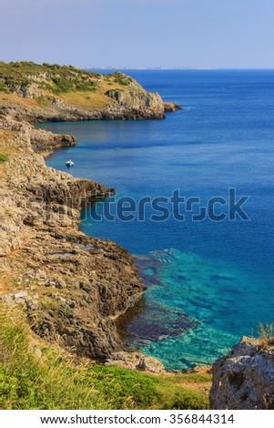 SUMMER SEASCAPE.Salento coast: Bay Uluzzo (Lecce).ITALY (Apulia).In the background the city of Gallipoli. Bay Uluzzo is a small natural gulf located within the protected area known as Porto Selvaggio. - stock photo