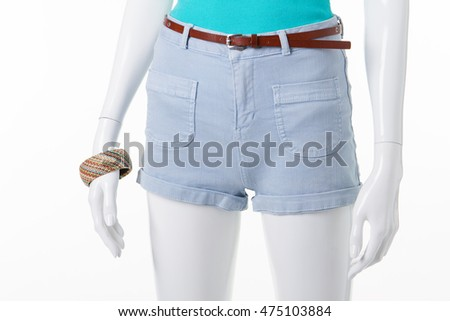 Summer shorts and a turquoise tank top on a white mannequin. Summer outfit for girls.