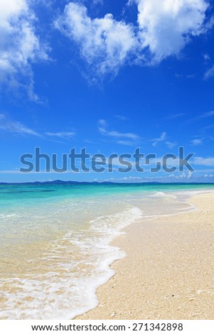 Summer sky and beautiful beach of Okinawa - stock photo
