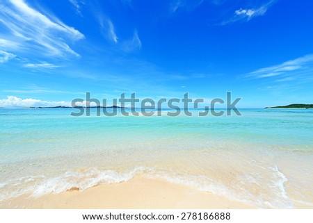 Summer sky and beautiful beach of Okinawa - stock photo