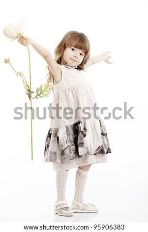 Summer smiling portrait of a little girl playing with a flower