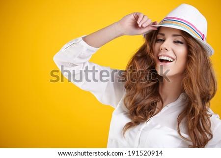Summer smiling woman in studio portrait  - stock photo