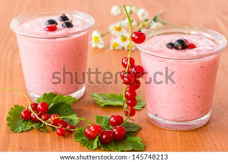 summer smoothies red currant in the cup on the wooden table