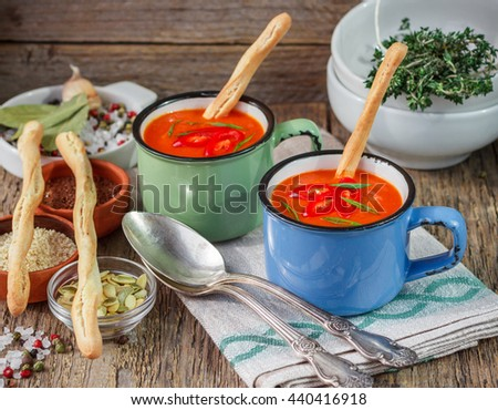 Summer soup. Spicy thick tomato soup with pepper, garlic, thyme and spices. In addition, flax seed, pumpkin seeds, sesame seeds. Selective focus - stock photo