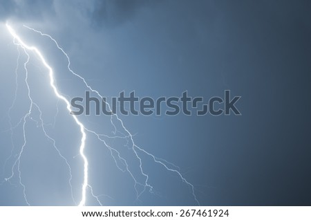 Summer storm with thunder, lightnings and rain. - stock photo