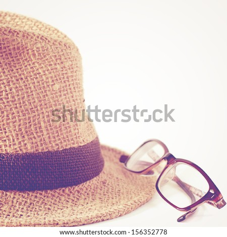 Summer straw hat with glasses with retro filter - stock photo