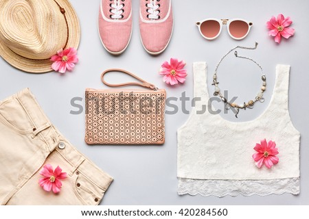 Summer street style. Fashion summer girl clothes set, accessories. Trendy sunglasses, gumshoes, top, handbag clutch, necklace hat,flowers. Summer lady. Creative urban overhead summer top view