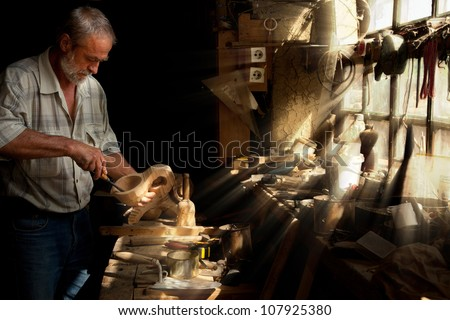 Summer sun beams shining on the hands of a skilled carpenter - stock photo