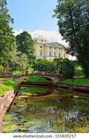 Summer sunny landscape of the Pavlovsk garden, Russia. View to the palace.