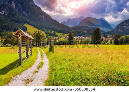 Summer sunny scene of Triglav mountain range, view from the Gozd Martuljek village, Julian Alps, Slovenia, Europe. - stock photo