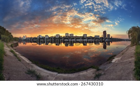 Summer sunset in the city. Reflection on the river in Donetsk. Ukraine - stock photo