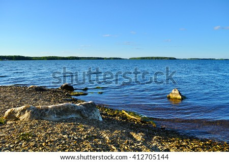 Summer sunset landscape - water area of Irtyash lake in Southern Urals, Russia.