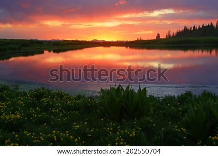 Summer sunset landscape with a colorful reflection in the Utah mountains, USA. - stock photo