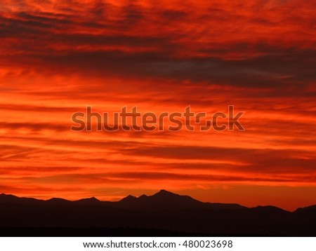 summer sunset over the front range and long's peak  as seen from broomfield, colorado