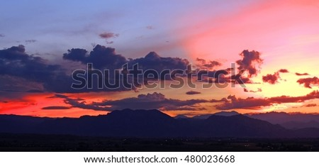summer sunset over the front range as seen from broomfield, colorado