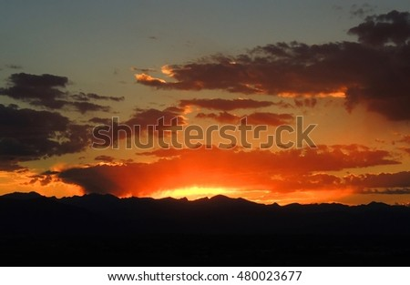 summer sunset over the front range of the Rocky Mountains  as seen from broomfield, colorado
